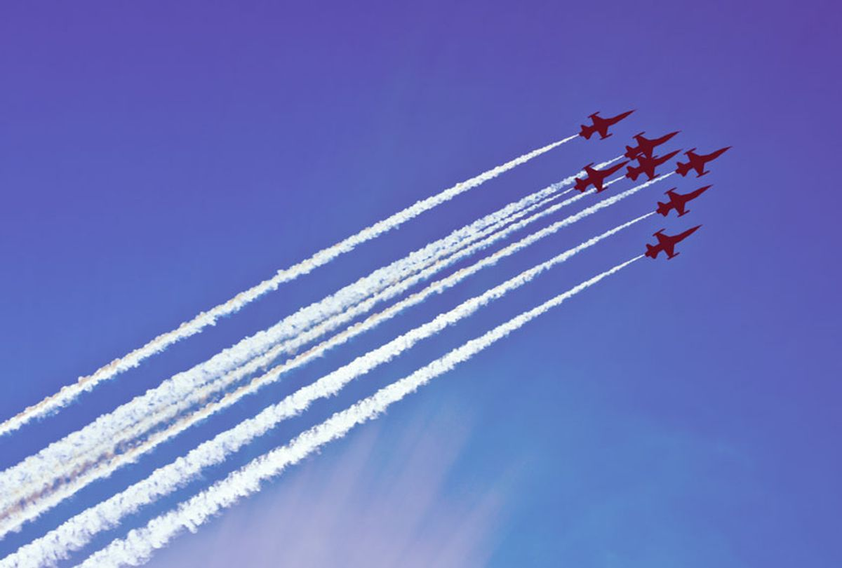 Silhouettes of seven fighter planes with exhaust trailing behind (Getty Images)