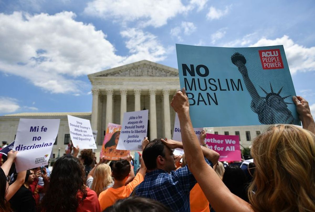 People protest the Muslim travel ban outside of the US Supreme Court in Washington, DC on June 26, 2018.  (Mandel Ngan/AFP via Getty Images)