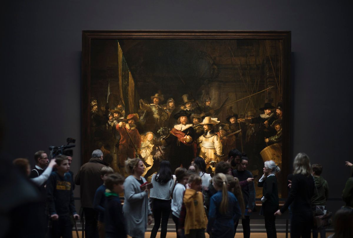 Visitors admire Rembrandt's Night Watch (1642), part of an exhibition of the all the Rijksmuseum's Rembrandts in Amsterdam, Netherlands, Wednesday, Feb. 13, 2019. (AP Photo/Peter Dejong)