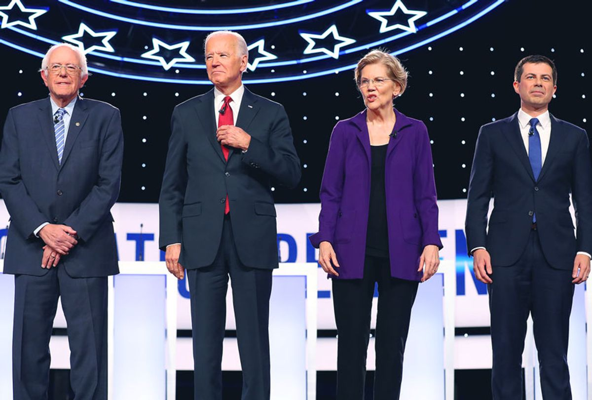 Democratic presidential candidates (L-R) Sen. Bernie Sanders (I-VT), former Vice President Joe Biden, Sen. Elizabeth Warren (D-MA) and South Bend, Indiana Mayor Pete Buttigieg at the start of the Democratic Presidential Debate at Otterbein University on October 15, 2019 in Westerville, Ohio. A record 12 presidential hopefuls are participating in the debate hosted by CNN and The New York Times. (Chip Somodevilla/Getty Images)