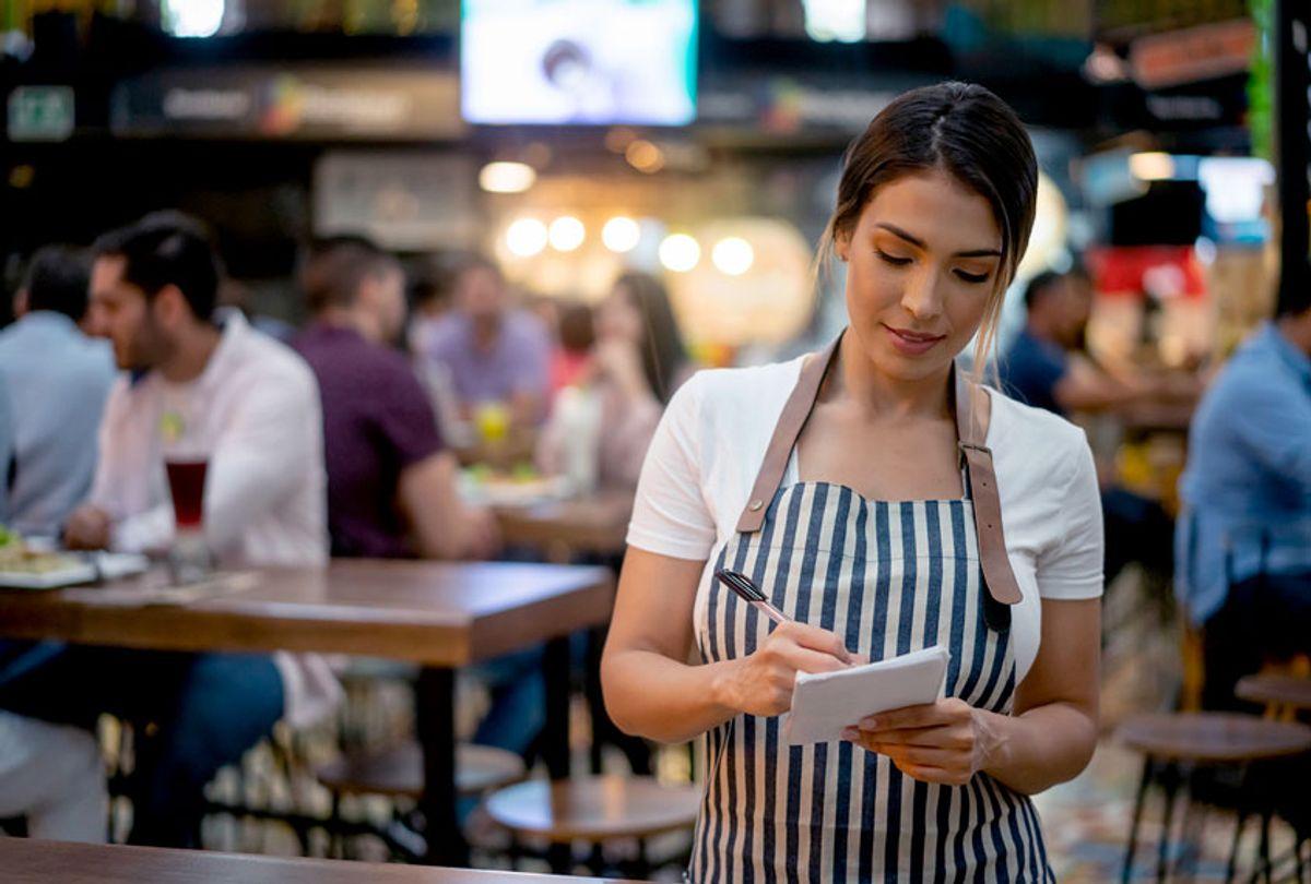 Waitress working at a restaurant (Getty Images)