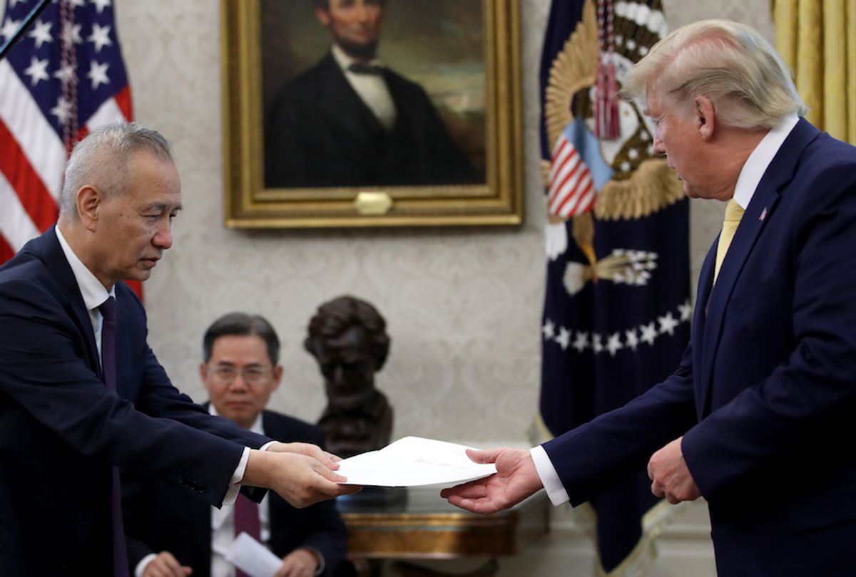 """Chinese Vice Premier Liu He presents U.S. President Donald Trump with a letter from Chinese President Xi Jinping after Trump announced a """"phase one"""" trade agreement with China in the Oval Office at the White House October 11, 2019 in Washington, DC.  China and the United States have slapped each other with hundreds of billions of dollars in tariffs since the current trade war began between the world's two largest national economies in 2018. (Photo by Win McNamee/Getty Images) (Win McNamee/Getty Images)"""