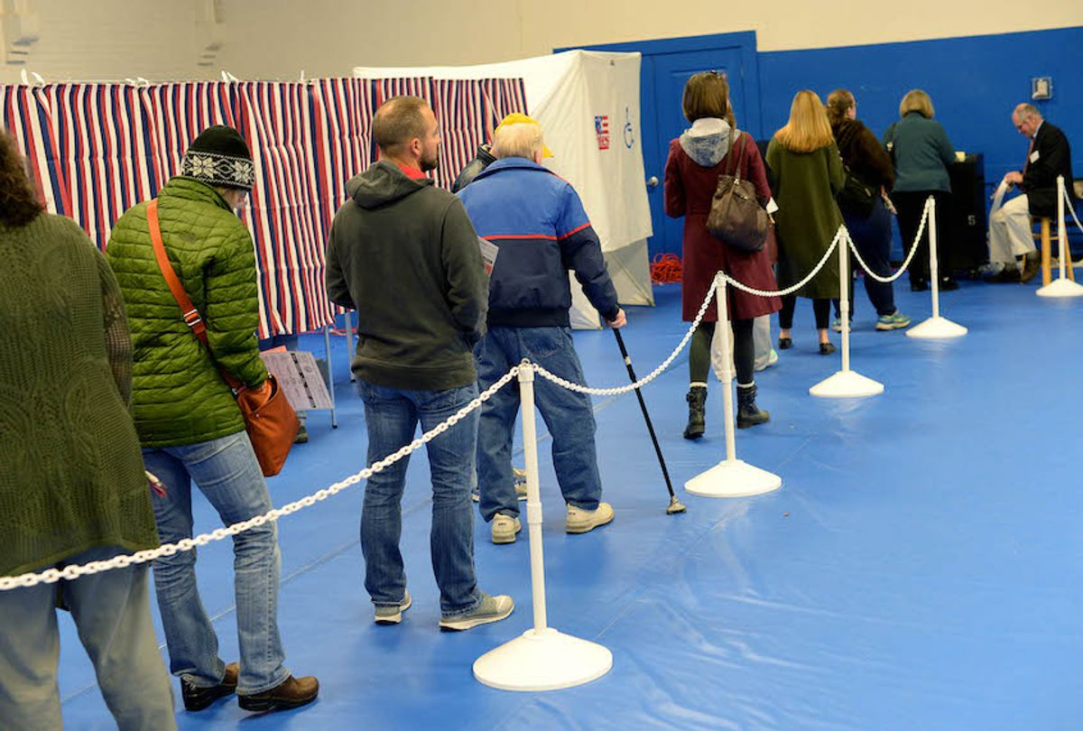 CONCORD, NH - NOVEMBER 08: Voters line up to cast their ballots at the Green Street Community Center on November 8, 2016 in Concord, New Hampshire. After a contentious campaign season, Americans go to the polls today to choose the next president of the United States. (Photo by Darren McCollester/Getty Images) (Darren McCollester/Getty Images)