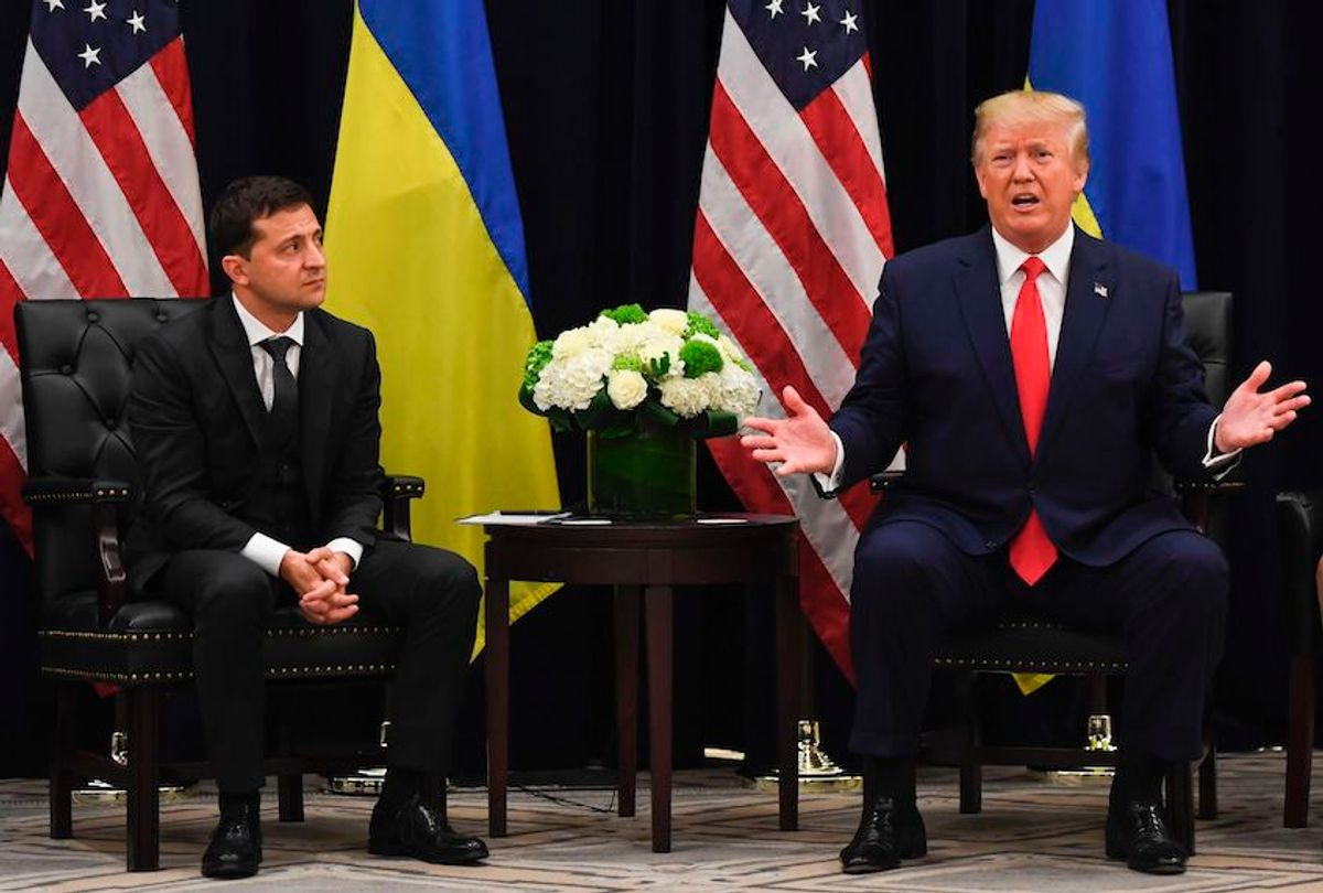 US President Donald Trump speaks as Ukrainian President Volodymyr Zelensky looks on during a meeting in New York on September 25, 2019, on the sidelines of the United Nations General Assembly. (Photo by SAUL LOEB / AFP)        (Photo credit should read SAUL LOEB/AFP/Getty Images) (Saul Loeb/AFP/Getty Images)