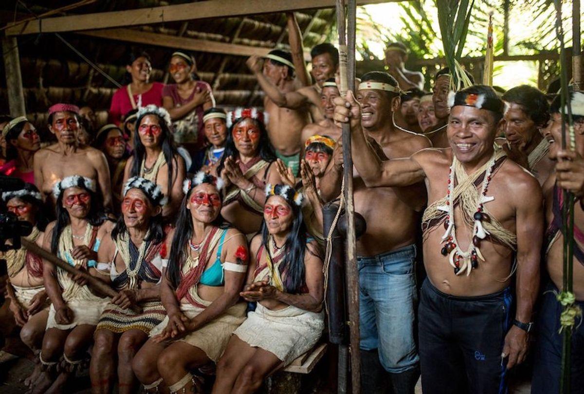 Waorani men and women participate in an assembly in ancestral Waorani territory, Pastaza, Ecuadorian Amazon. (Amazon Frontlines)
