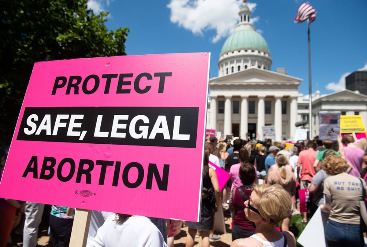 Protesters hold signs as they rally in support of Planned Parenthood and pro-choice (SAUL LOEB/AFP via Getty Images)