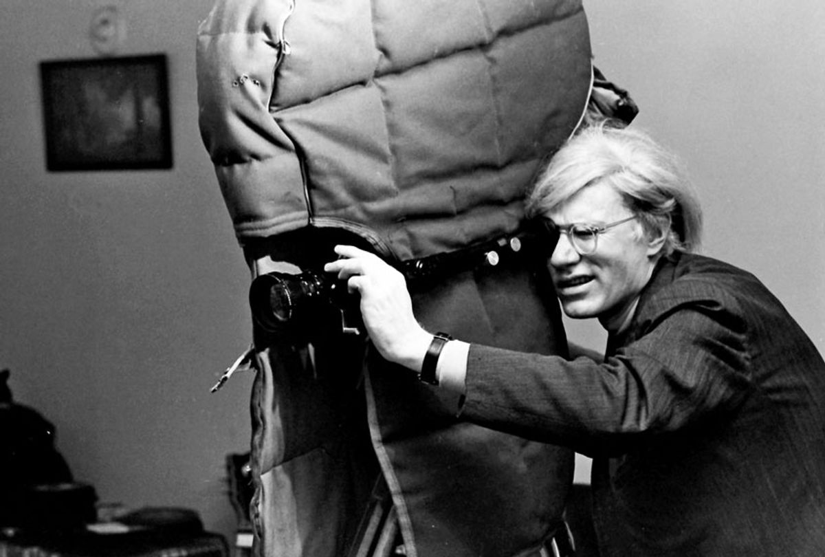 """Andy Warhol filming an early scene of director Paul Morrisey's """"Women in Revolt,"""" 1970. (Jack Mitchell/Getty Images)"""