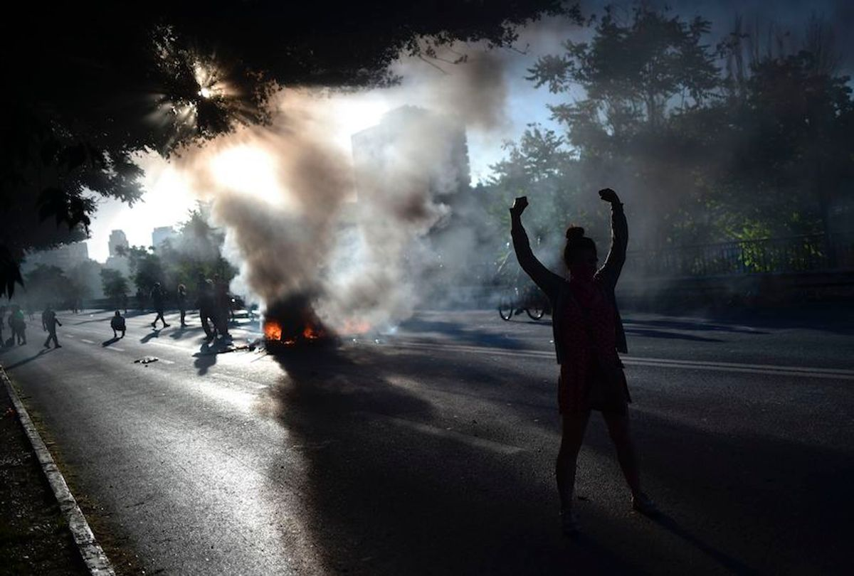 People demonstrate by a bonfire during a protest against the government in Santiago on November 15, 2019.  (Rodrigo Arangua/AFP via Getty Images)