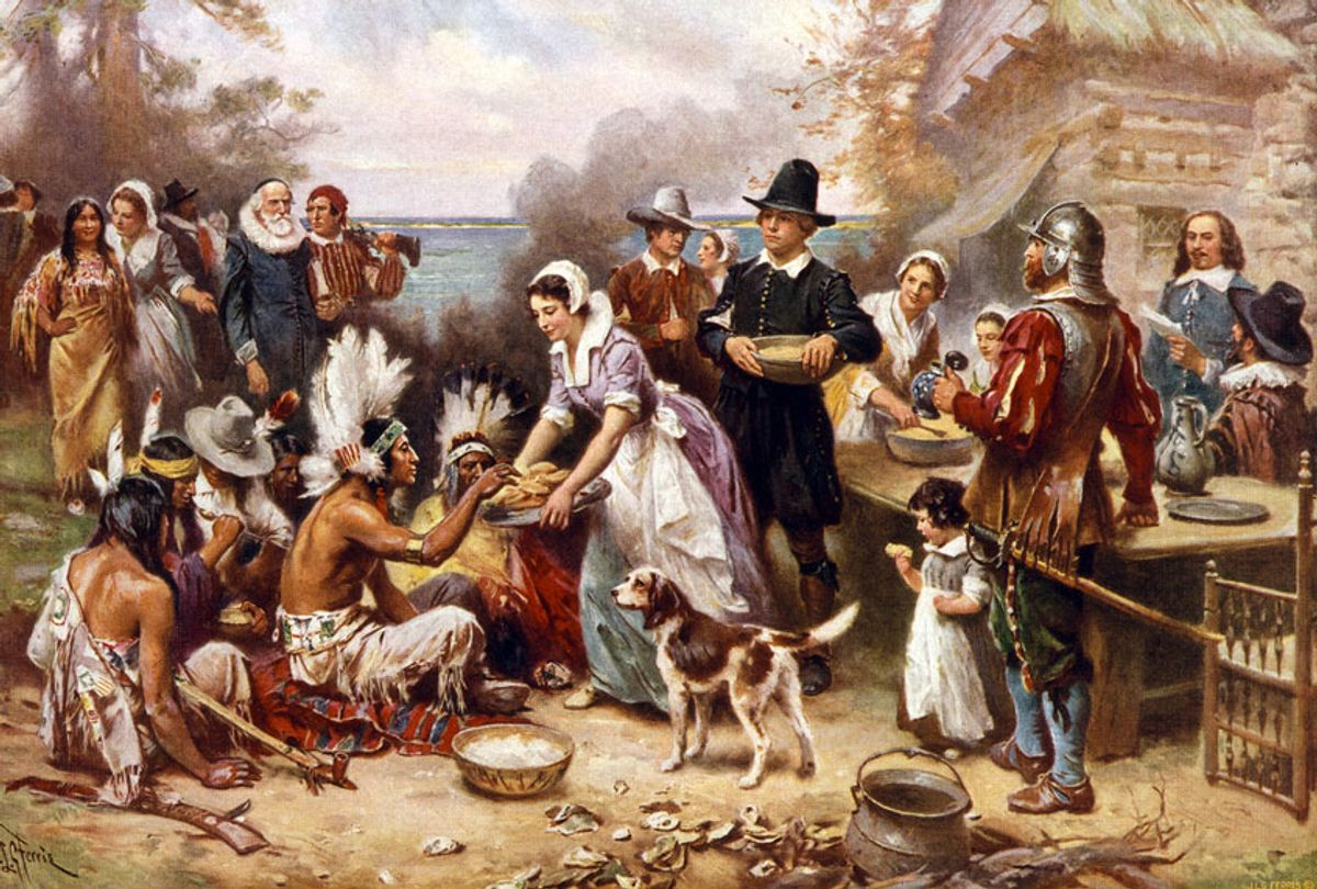 The First Thanksgiving, 1621 by Jean Leon Gerome Ferris, 1863-1930, artist. Published by the Foundation Press, Inc., c1932. Photomechanical print halftone, colour. Pilgrims and Natives gather to share meal. (Photo by:  (Photo12/Universal Images Group via Getty Images)