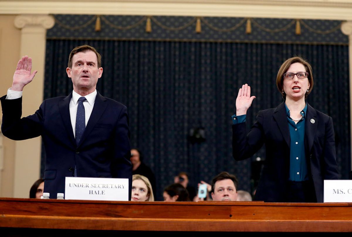 Deputy Assistant Secretary of Defense Laura Cooper, right, and State Department official David Hale, are sworn in to testify before the House Intelligence Committee on Capitol Hill in Washington, Wednesday, Nov. 20, 2019, during a public impeachment hearing of President Donald Trump's efforts to tie U.S. aid for Ukraine to investigations of his political opponents. (AP Photo/Andrew Harnik)