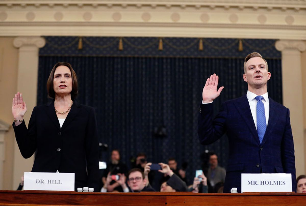 Former White House national security aide Fiona Hill, left, and David Holmes, a U.S. diplomat in Ukraine, are sworn in to testify before the House Intelligence Committee on Capitol Hill in Washington, Thursday, Nov. 21, 2019, during a public impeachment hearing of President Donald Trump's efforts to tie U.S. aid for Ukraine to investigations of his political opponents.  (AP Photo/Andrew Harnik)
