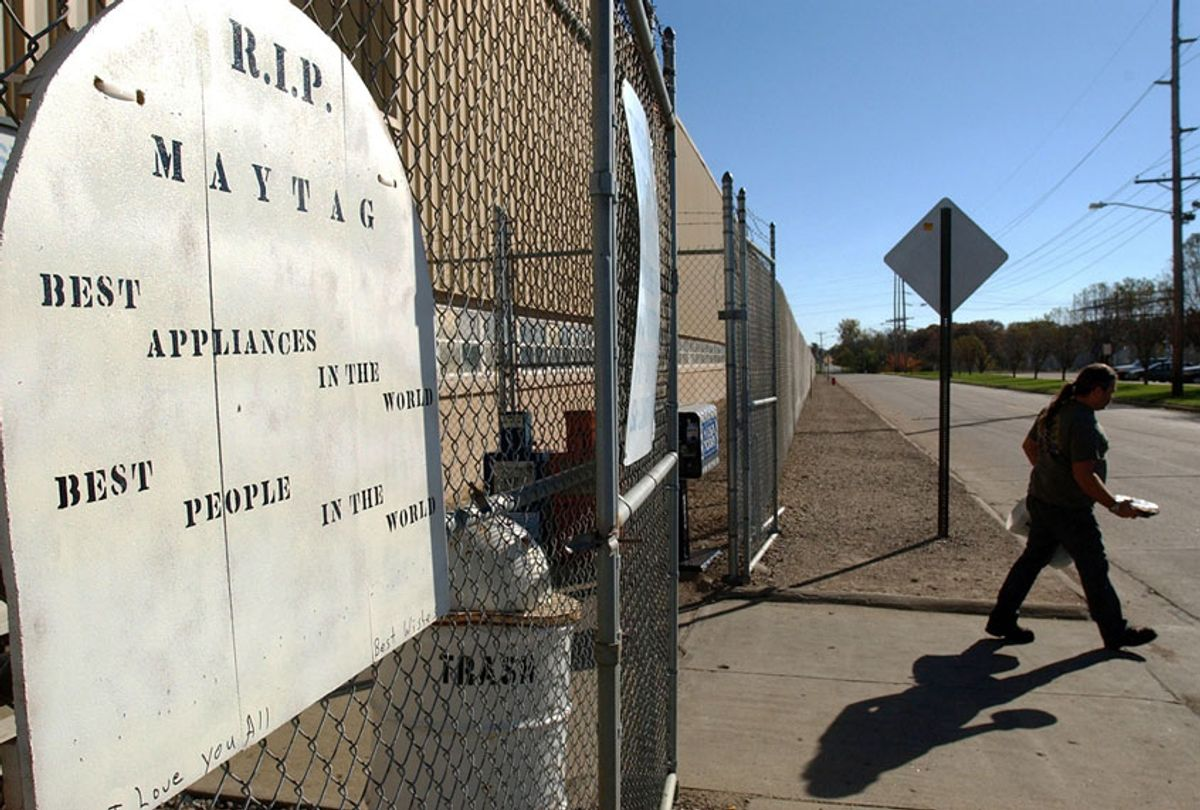 A R.I.P. sign hangs on the gate as a worker exits the plant on the eve of the final day of production at the Maytag plant in Newton, Iowa (AP Photo/Steve Pope)
