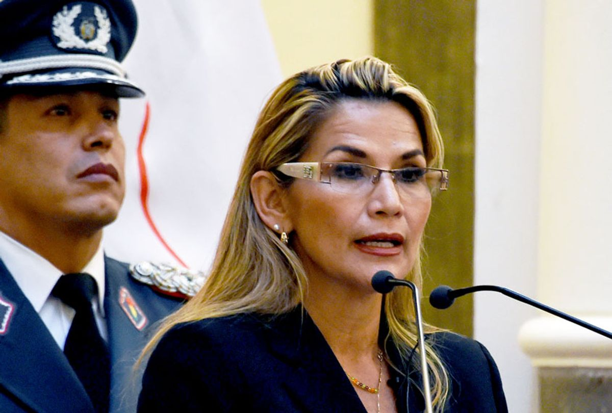 """Bolivia's interim president, Jeanine Anez speaks while taking oath to the military command during her first day in power, at the Quemado presidential palace in La Paz, on November 13, 2019. - Anez, who declared herself interim president before her claim was endorsed by the constitutional court, arguing that her succession was necessitated by the resignations of those above her in the government hierarchy, will try to fill the power vacuum left by Evo Morales's abrupt resignation, as the former leader denounced what he described as a """"sneaky coup."""" (AIZAR RALDES/AFP via Getty Images)"""