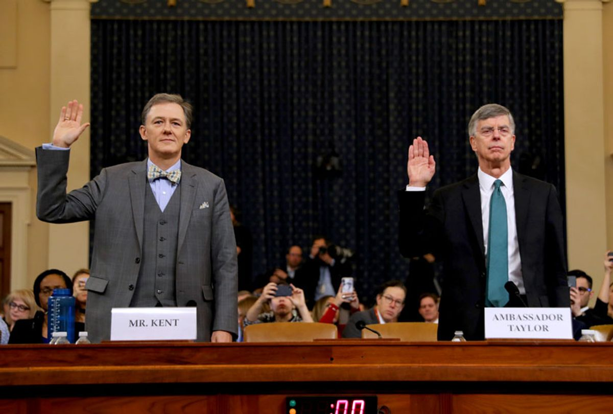 Deputy Assistant Secretary for European and Eurasian Affairs George P. Kent (L) and top U.S. diplomat in Ukraine William B. Taylor Jr. are sworn in before testifying before the House Intelligence Committee in the Longworth House Office Building on Capitol Hill November 13, 2019 in Washington, DC. In the first public impeachment hearings in more than two decades, House Democrats are trying to build a case that President Donald Trump committed extortion, bribery or coercion by trying to enlist Ukraine to investigate his political rival in exchange for military aide and a White House meeting that Ukraine President Volodymyr Zelensky sought with Trump. (Chip Somodevilla/Getty Images)