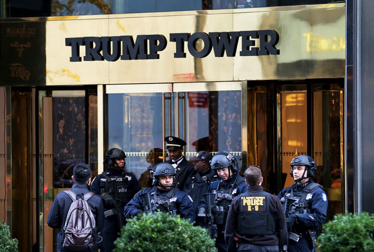 In this Nov. 17, 2016 file photo, security personnel stand at the front entrance of Trump Tower in New York. The Trump administration is asking for more money to protect President Donald Trump's signature New York skyscraper, add hundreds of new Secret Service agents and beef up security at the White House, according to new budget documents presented to Congress. (AP Photo/Seth Wenig)