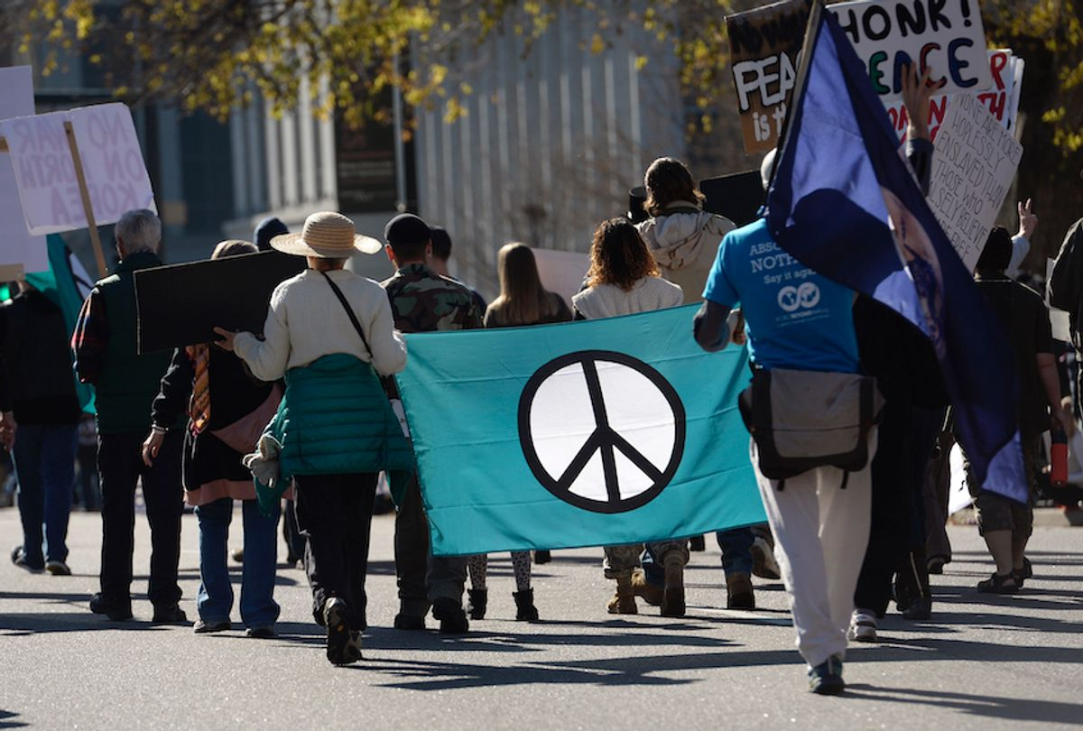 Members of Veterans for Peace and About Face: Veterans Against the War, march down Lincoln Street during the Denver Veterans Day Parade, hosted by the Colorado Veterans Project in downtown on November 11, 2017 in Denver, Colorado. The parade, comprised of local veterans organizations, lines Civic Center Park and nearby streets and is broken down into serials that represent a different conflict in military history.  (Kathryn Scott/The Denver Post via Getty Images)