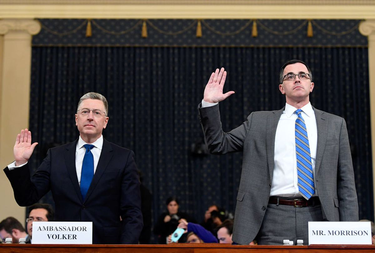 Ambassador Kurt Volker, left, former special envoy to Ukraine, and Tim Morrison, a former official at the National Security Council are sworn in to testify before the House Intelligence Committee on Capitol Hill in Washington, Tuesday, Nov. 19, 2019, during a public impeachment hearing of President Donald Trump's efforts to tie U.S. aid for Ukraine to investigations of his political opponents. ( (AP Photo/Susan Walsh)