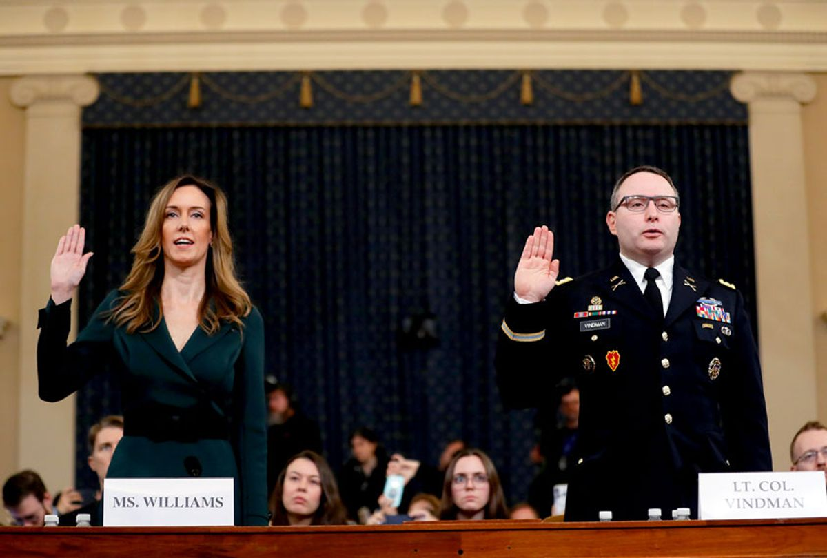 Jennifer Williams, an aide to Vice President Mike Pence, left, and National Security Council aide Lt. Col. Alexander Vindman, are sworn in to testify before the House Intelligence Committee on Capitol Hill in Washington, Tuesday, Nov. 19, 2019, during a public impeachment hearing of President Donald Trump's efforts to tie U.S. aid for Ukraine to investigations of his political opponents.  (AP Photo/Andrew Harnik)