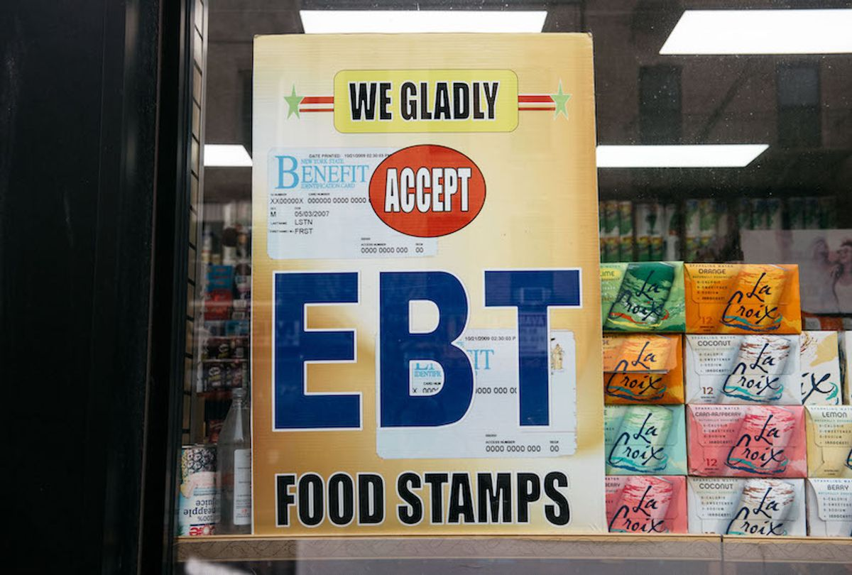 A sign alerting customers about SNAP food stamps benefits is displayed at a Brooklyn grocery store on December 5, 2019 in New York City, United States. (Photo by Scott Heins/Getty Images)