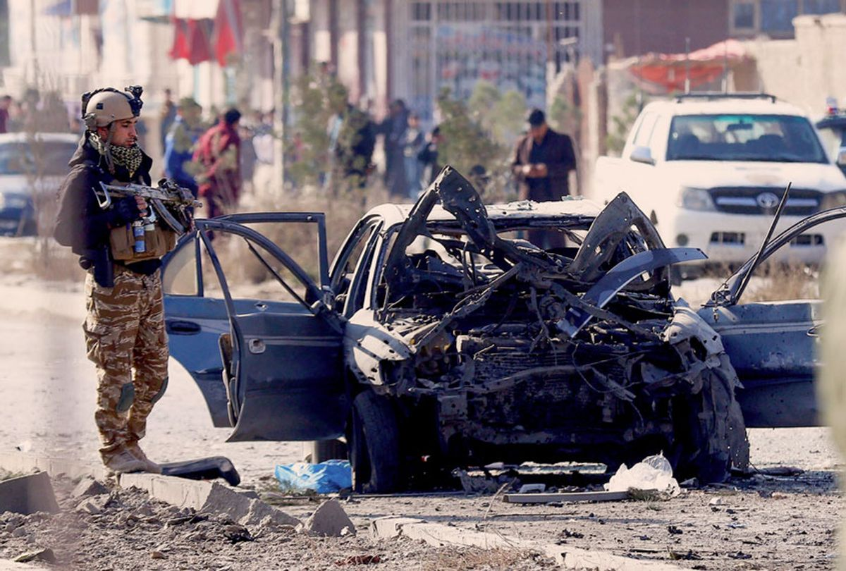 A soldier stands next to the site of a suicide attack in Kabul on November 13, 2019. - At least seven people were killed and seven wounded when a car bomb detonated during Kabul's busy morning rush hour on November 13, an interior ministry spokesman said. (Photo by STR / AFP) (Photo by  (STR/AFP via Getty Images)