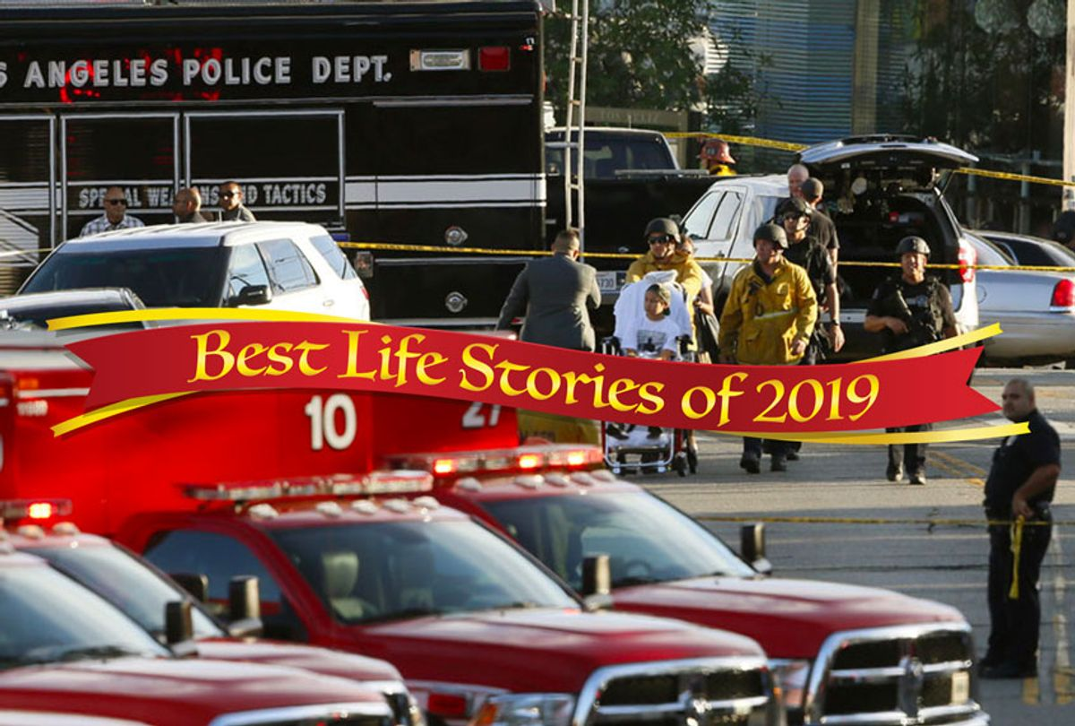 Los Angeles Police SWAT officers, and Los Angeles firemen wearing bulletproof helmets, evacuate a child, after a gunman barricaded himself inside a Trader Joe's store in Los Angeles, July 21, 2018. (AP/Damian Dovargane)