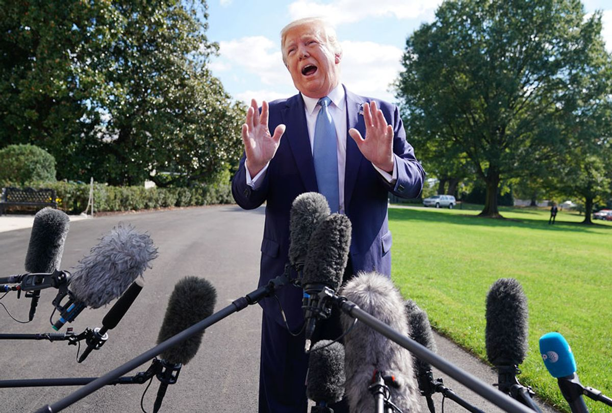 U.S. President Donald Trump talks to journalists on the South Lawn of the White House before boarding Marine One and traveling to Walter Reed National Military Medical Center October 04, 2019 in Washington, DC. According to the White House, Trump will be visiting injured military service members. (Chip Somodevilla/Getty Images)