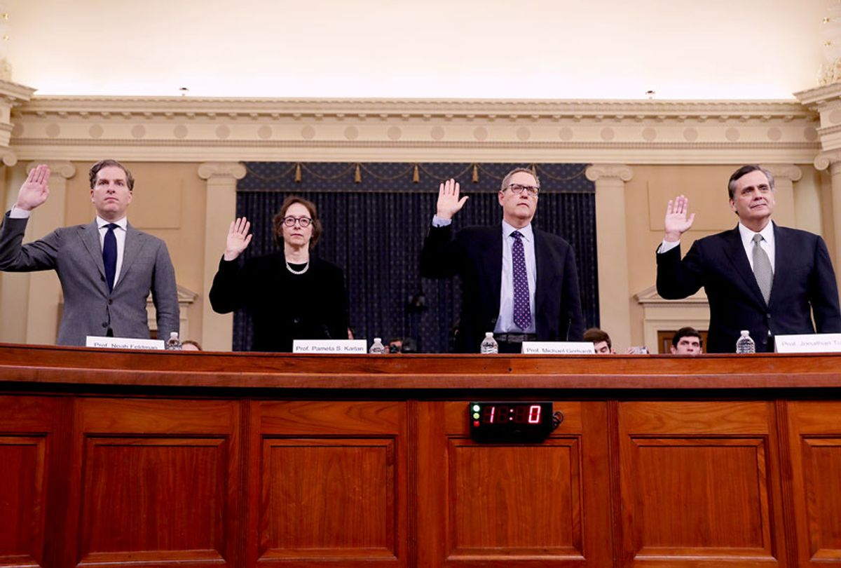 Constitutional scholars Noah Feldman of Harvard University, Pamela Karlan of Stanford University, Michael Gerhardt of the University of North Carolina, and Jonathan Turley of George Washington University are sworn in to testify before the House Judiciary Committee in the Longworth House Office Building on Capitol Hill December 4, 2019 in Washington, DC. This is the first hearing held by the Judiciary Committee in the impeachment inquiry against U.S. President Donald Trump, whom House Democrats say held back military aid for Ukraine while demanding it investigate his political rivals. The Judiciary Committee will decide whether to draft official articles of impeachment against President Trump to be voted on by the full House of Representatives. (Chip Somodevilla/Getty Images)