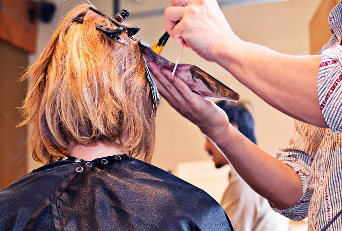 Woman having her hair colored in salon  (Getty Images)
