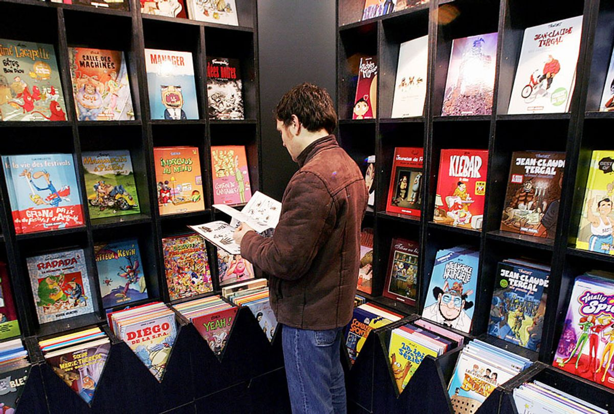 A man reads a comic book at the International Comics Festival in Angouleme southern France. (PIERRE ANDRIEU/AFP via Getty Images)
