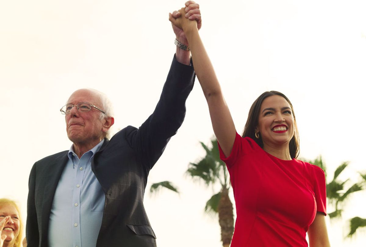 Democratic presidential candidate Sen. Bernie Sanders, I-Vt., and Rep. Alexandria Ocasio-Cortez, D-N.Y., greet the crowd during a rally in Venice, Calif., Saturday, Dec. 21, 2019. (AP Photo/Kelvin Kuo)