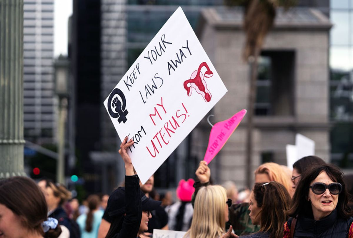 An activist seen holding a placard that says keep your laws away from my uterus during the protest. (Ronen Tivony/SOPA Images/LightRocket via Getty Images)