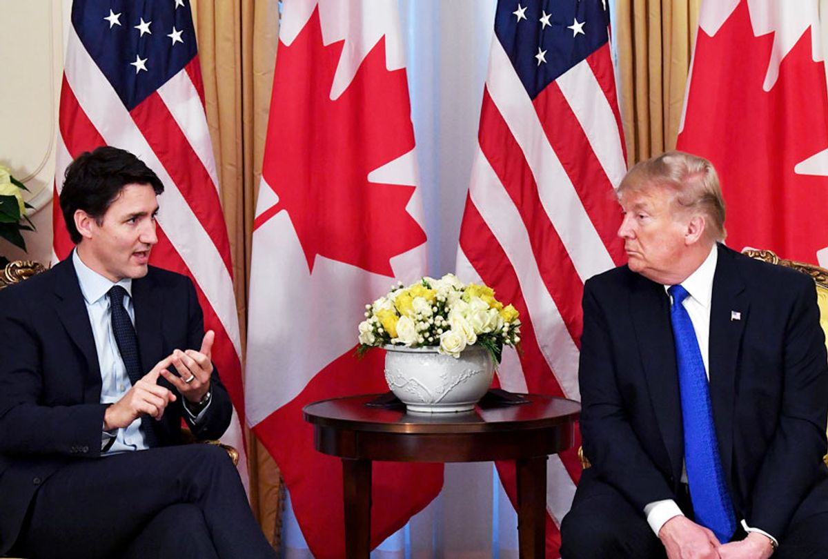 US President Donald Trump listens to Canada's Prime Minister Justin Trudeau during a meeting at Winfield House, London on December 3, 2019. - NATO leaders gather Tuesday for a summit to mark the alliance's 70th anniversary but with leaders feuding and name-calling over money and strategy, the mood is far from festive.  (NICHOLAS KAMM/AFP via Getty Images)