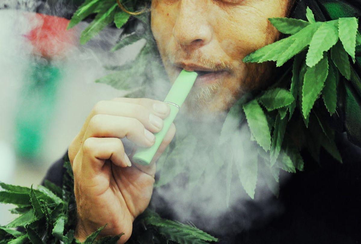 A man calling himself Henry Hemp inhales marijuana using a vaporizer pen at HempCon medical marijuana show (ROBYN BECK/AFP via Getty Images)