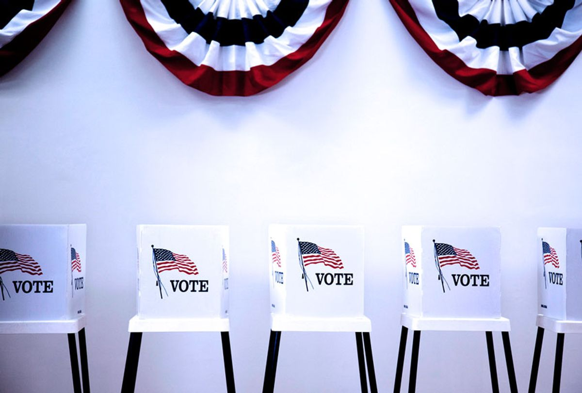 Voting booths in polling place (Getty Images/Hill Street Studios)