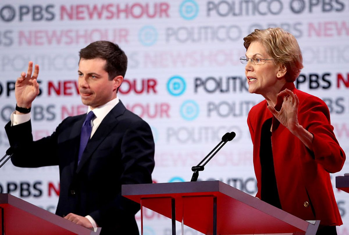 Sen. Elizabeth Warren (D-MA) speaks as South Bend, Indiana Mayor Pete Buttigieg raises his hand during the Democratic presidential primary debate at Loyola Marymount University on December 19, 2019 in Los Angeles, California. Seven candidates out of the crowded field qualified for the 6th and last Democratic presidential primary debate of 2019 hosted by PBS NewsHour and Politico. (Justin Sullivan/Getty Images)