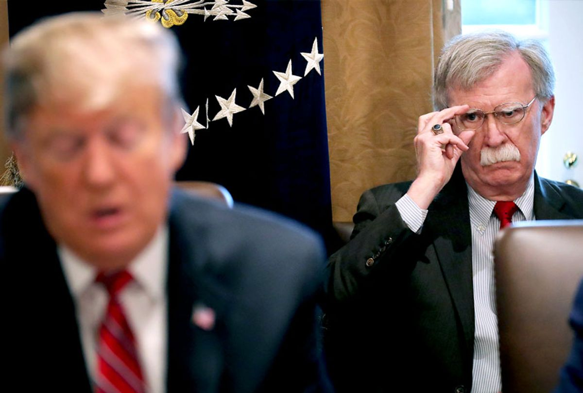 National Security Advisor John Bolton (R) listens to U.S. President Donald Trump talk to reporters during a meeting of his cabinet in the Cabinet Room at the White House (Chip Somodevilla/Getty Images)