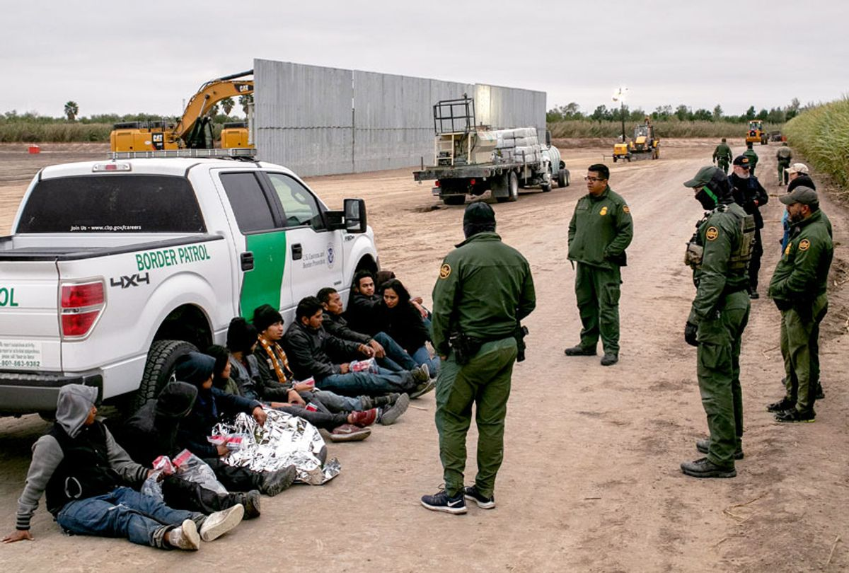 U.S. Border Patrol agents detain undocumented immigrants caught near a section of privately-built border wall under construction on December 11, 2019 near Mission, Texas. The hardline immigration group We Build The Wall is funding construction of the wall on private land along the Rio Grande, which forms the border with Mexico. The group, led by former Trump strategist Stephen Bannon claims to have raised tens of millions of dollars in a GoFundMe drive to build sections of wall along stretches of the U.S. southwest border with Mexico.  (John Moore/Getty Images)