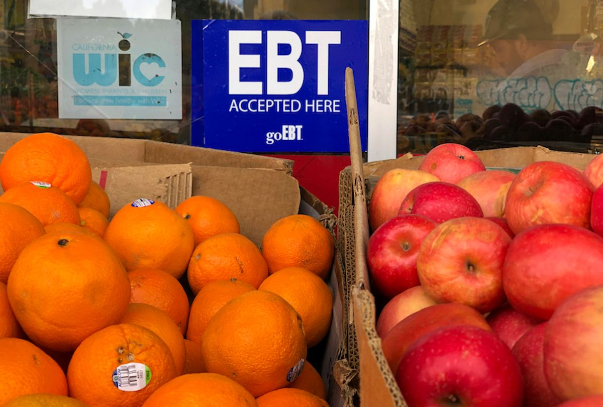 A sign noting the acceptance of electronic benefit transfer (EBT) cards that are used by state welfare departments to issue benefits is displayed at a grocery store on December 04, 2019 in Oakland, California. (Justin Sullivan/Getty Images)