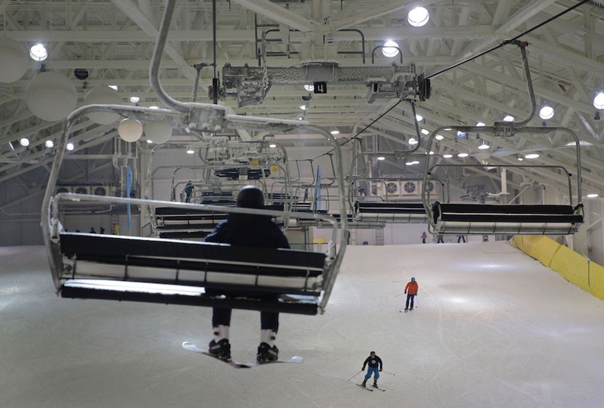 Snowboarders and skiers enjoy the grand opening of Big Snow in East Rutherford, N.J., Thursday, Dec. 5, 2019. The facility, which is part of the American Dream mega-mall, is North America's first indoor ski and snowboard facility with real snow.  (AP Photo/Seth Wenig)