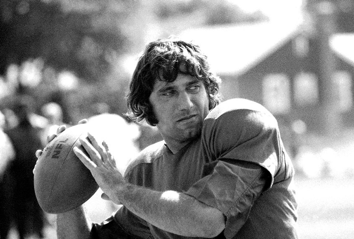 New York Jets' quarterback Joe Namath practices hurling the ball at the team's training camp at Hofstra University on Long Island, Aug. 18, 1970. Earlier Namath said he didn?t think he could play ball this season, blaming both business and physical problems for his statement. Namath checked into the training camp on August 18 after almost two weeks' being listed as AWOL.  (AP Photo/Harry Harris)
