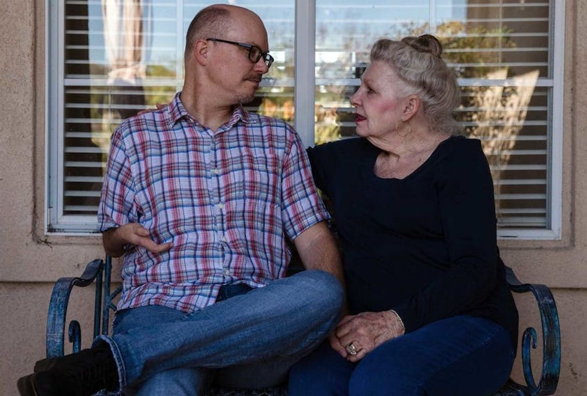 Joyce Daubert and her son Jason in front of Joyce's home in Ramona, California. (Ariana Drehsler/Undark)