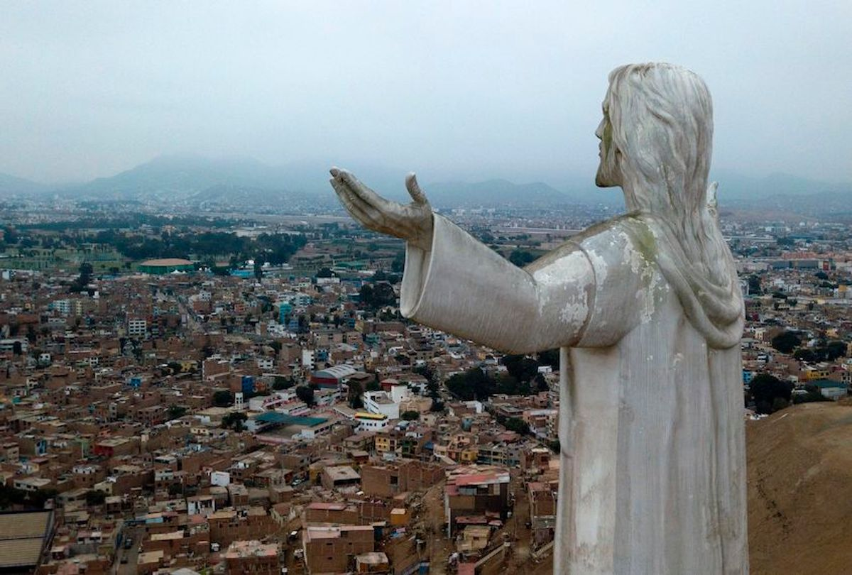 """View of the """"Christ of the Pacific"""" statue atop a hill in Lima, on July 15, 2019. The giant statute of Jesus Christ that looms large over Lima has caused controversy in Peru because of its financing by the graft-tainted Brazilian construction giant Odebrecht and late ex-president Alan Garcia.  (Cris Bouroncle/AFP via Getty Images)"""