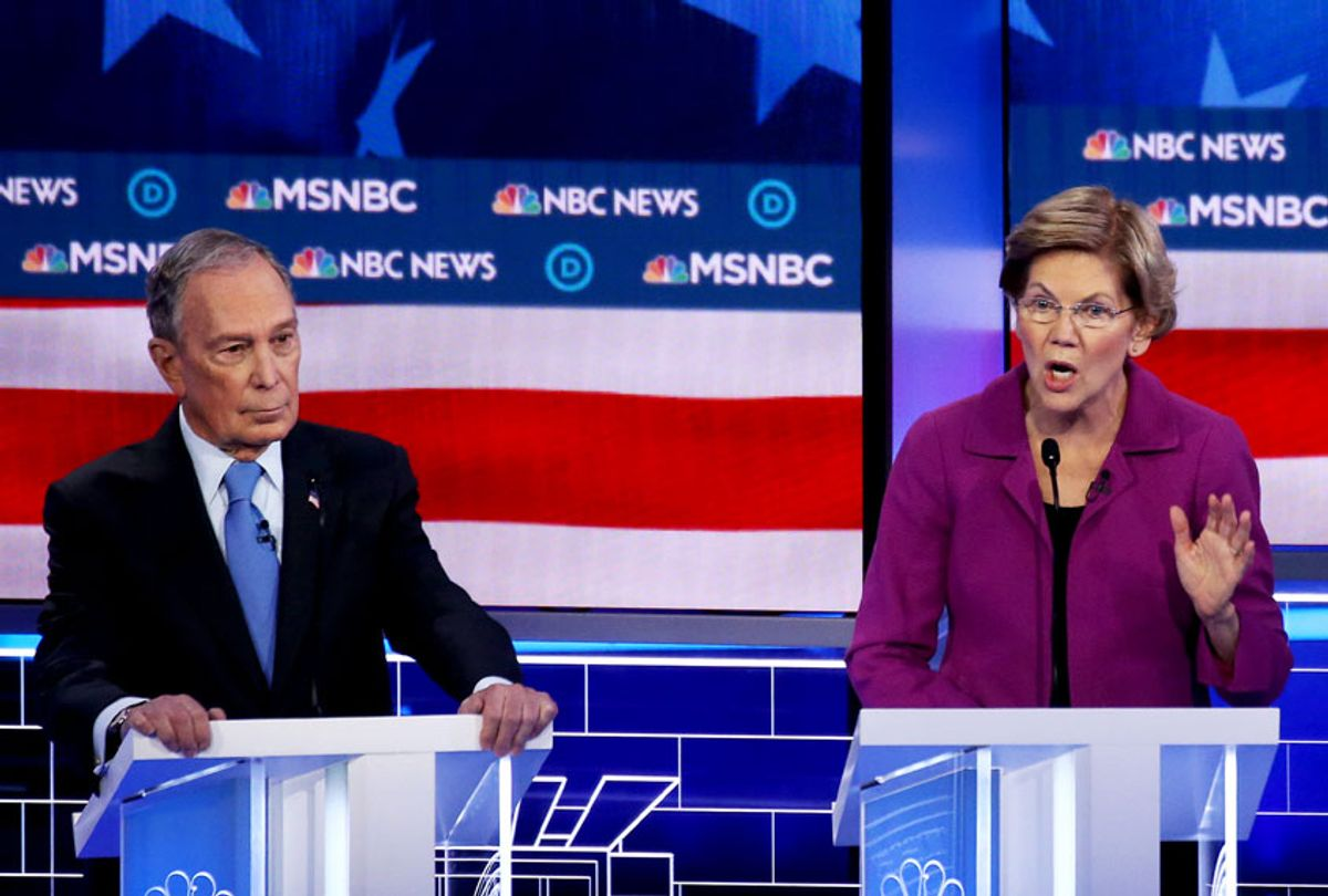 Democratic presidential candidate (L) former New York City Mayor Mike Bloomberg and Sen. Bernie Sanders (I-VT) listen as Sen. Elizabeth Warren (D-MA) speaks during the Democratic presidential primary debate at Paris Las Vegas on February 19, 2020 in Las Vegas, Nevada. Six candidates qualified for the third Democratic presidential primary debate of 2020, which comes just days before the Nevada caucuses on February 22.  (Mario Tama/Getty Images)