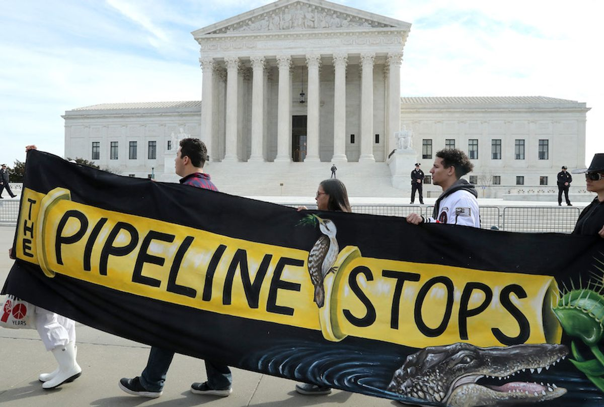 Climate activist groups protest in front of the U.S. Supreme Court as oral arguments are heard in U.S. Forest Service and Atlantic Coast Pipeline, LLC v. Cowpasture River Assn. case, on February 24, 2020 in Washington, DC. (Mark Wilson/Getty Images)