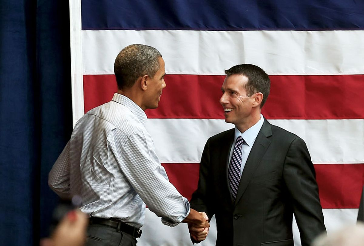 David Plouffe, a senior adviser to U.S. President Barack Obama, is greeted by the president after introducing him at a fundraising reception at the Bridgeport Arts Center on August 12, 2012 in Chicago, Illinois. On Monday Obama will begin a three-day, nine-city campaign trip through Iowa. (Scott Olson/Getty Images)