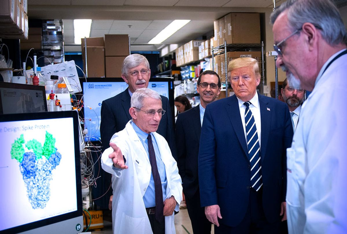 """National Institute of Allergy and Infectious Diseases Director Tony Fauci (L) speaks to US President Donald Trump during a tour of the National Institutes of Health's Vaccine Research Center March 3, 2020, in Bethesda, Maryland. - The US Federal Reserve announced an emergency rate cut responding to the growing economic risk posed by the coronavirus epidemic after the UN health agency said the world has entered """"uncharted territory"""" with the outbreak's rapid spread.  (Brendan Smialowski/AFP via Getty Images)"""