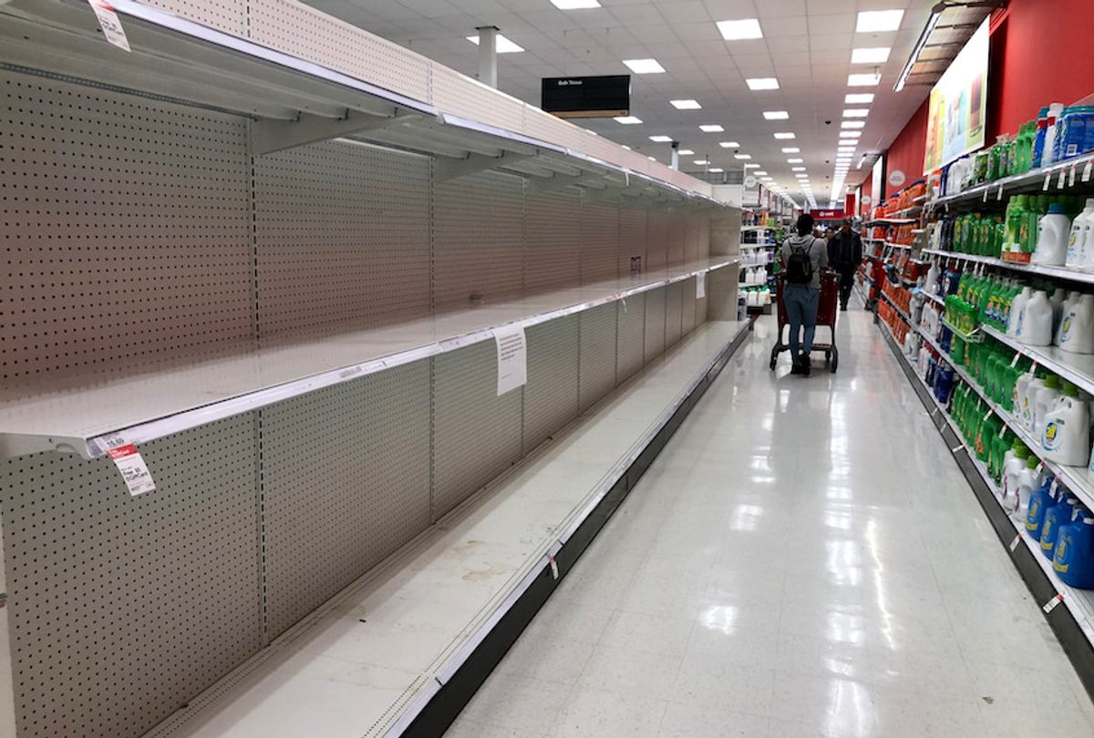 Empty shelves are visible at a Target store on March 13, 2020 in San Rafael, California. (Justin Sullivan/Getty Images)