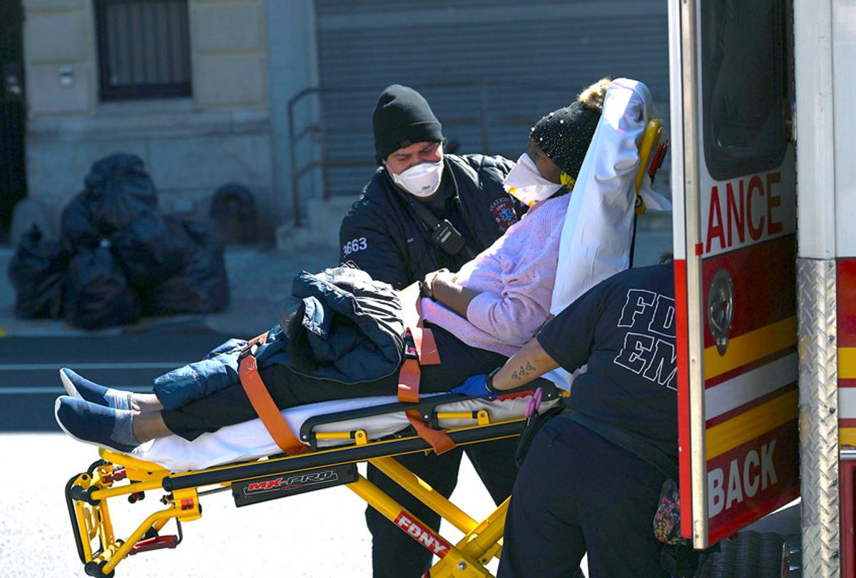 Paramedics carry a stretcher with a patient out of an ambulance at Brooklyn Hospital Center on March 27, 2020 in New York City. (ANGELA WEISS/AFP via Getty Images)