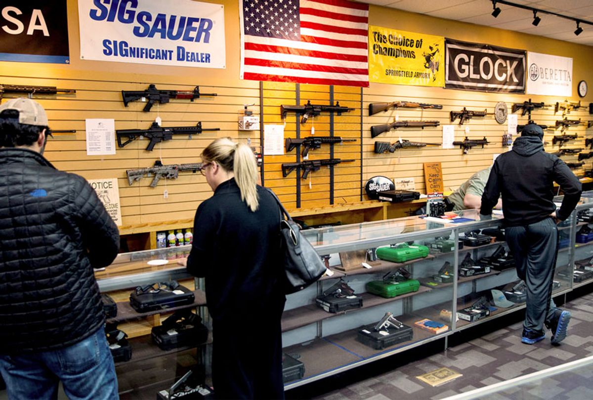 Customers shop at Blue Ridge Arsenal in Chantilly, Va., USA (Samuel Corum/Anadolu Agency/Getty Images)
