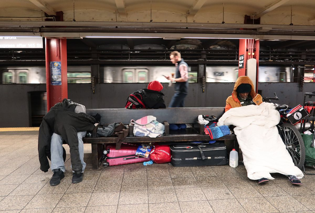 Homeless people sleep in the 42nd St-Bryant Park Subway station on March 9, 2020 in New York City.  (Gary Hershorn/Corbis via Getty Images)